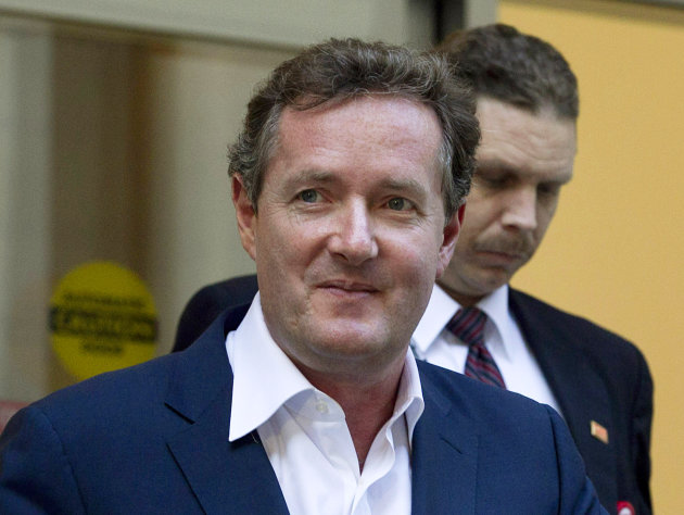 FILE - In this Dec. 20, 2011 file photo, Piers Morgan, host of CNN&#39;s &quot;Piers Morgan Tonight,&quot; leaves the CNN building in Los Angeles. Former U.S. President Bill Clinton&#39;s convention speech nominating President Barack Obama for a second term left Morgan star-struck: &quot;Already the best speech of either convention,&quot; the prime-time talk show host tweeted. &quot;An oratorical genius right up there with Churchill, Kennedy, MLK and Mandela.&quot; (AP Photo/Jae C. Hong, File)