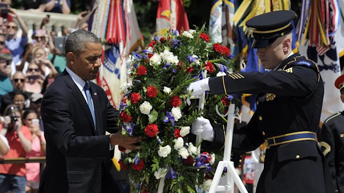 President Barack Obama lays a wreath at the Tomb of the Unknowns at Arlington National Cemetery in Arlington, Va., Monday, May 26, 2014. President Obama is leading the nation in remembering its war heroes, the fallen and those still defending the flag, in a Memorial Day tribute. (AP Photo/Susan Walsh)