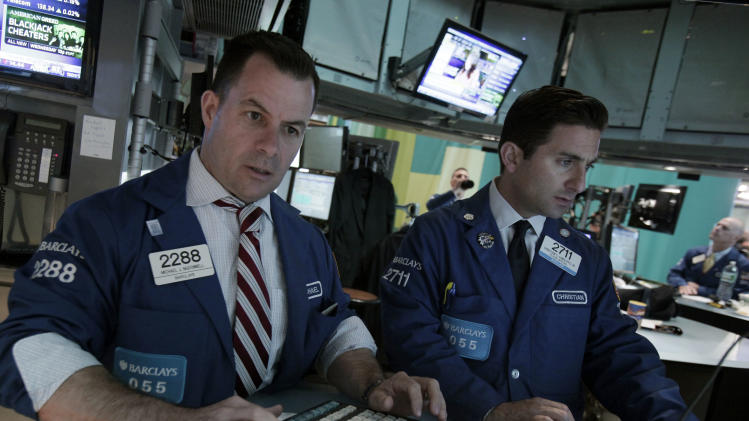 Specialists Michael McDonnell, left, and Christian Sanfilippo work on the floor of the New York Stock Exchange Tuesday, May 29, 2012. Stocks are opening higher on Wall street on optimism that China will take action to reverse a slowdown in its economic growth. (AP Photo/Richard Drew)