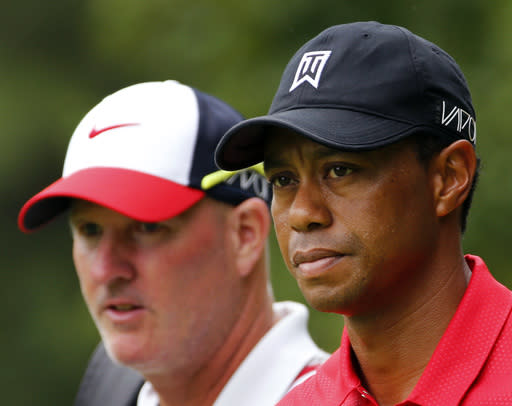 Woods' caddie sticking by his man, thinks he can still win