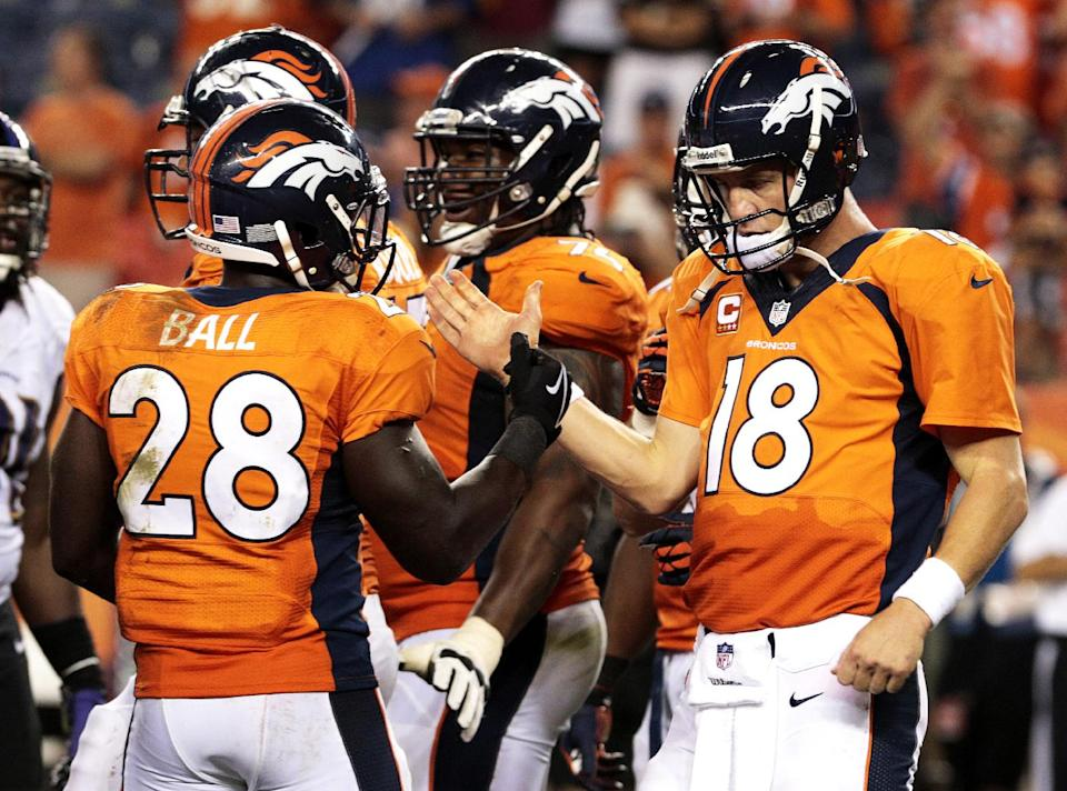 Denver Broncos quarterback Peyton Manning (18) greets teammate Montee Ball (28) as time expires in an NFL football game against the Baltimore Ravens, Thursday, Sept. 5, 2013, in Denver. The Broncos won 49-27. (AP Photo/Joe Mahoney)