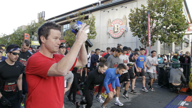 Celebrity hostBilly Bushsounds a horn to signal the start of the Men's Health Urbanathlon, Sunday, November 18, 2012 in San Francisco. The Men's Health Urbanathlon is a rigorous 9 mile course, packed with challenging urban obstacles set against the backdrop of iconic city landmarks.(Photo by Tony Avelar/Invision for Men's Health/AP Images)