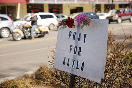 A sign for Kayla Mueller is displayed along a main street in Prescott