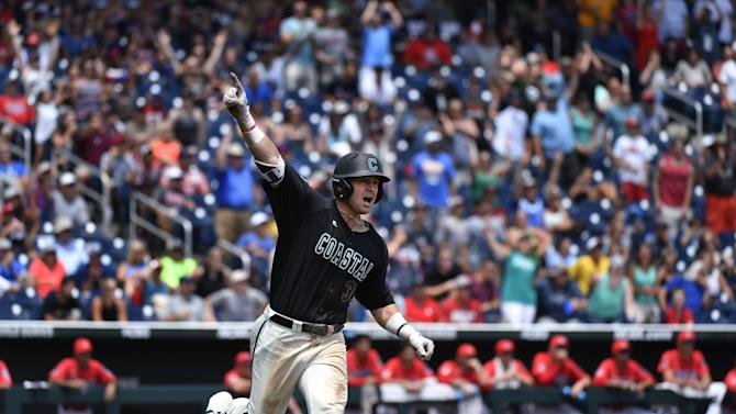 Coastal Carolina's G.K. Young celebrates his two-run home run against Arizona pitcher Bobby Dalbec in the  sixth inning in Game 3 of the NCAA College World Series baseball finals in Omaha, Neb., Thursday, June 30, 2016. (AP Photo/Ted Kirk)