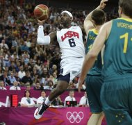 USA&#39;s Lebron James drives to the basket against Australia during a men&#39;s quarterfinals basketball game at the 2012 Summer Olympics, Wednesday, Aug. 8, 2012, in London. (AP Photo/Charles Krupa)