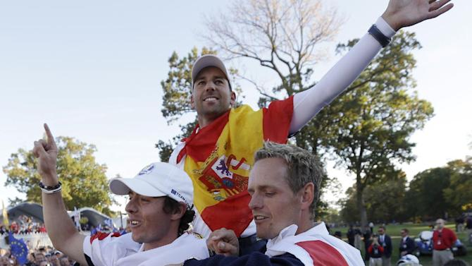 Europe's Rory McIlroy, Sergio Garcia and Luke Donald celebrate after winning the Ryder Cup PGA golf tournament Sunday, Sept. 30, 2012, at the Medinah Country Club in Medinah, Ill. (AP Photo/David J. Phillip)