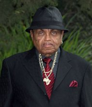 FILE - In this Sept. 3, 2009 file photo, Michael Jackson&#39;s father Joe Jackson leaves the family residence in the Encino section of Los Angeles for his son&#39;s funeral. Joe Jackson dismissed his wrongful death lawsuit against the former physician Conrad Murray convicted of involuntary manslaughter on Monday Aug. 13, 2012. (AP Photo/Nick Ut, File)