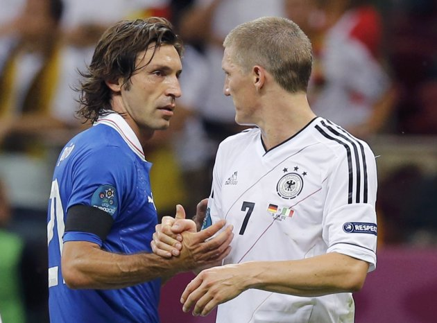 Germany's Schweinsteiger congratulates to Italy's Pirlo after the Euro 2012 semi-final soccer match at National Stadium in Warsaw