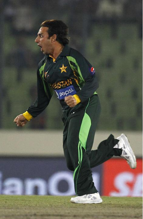 Pakistan's Saeed Ajmal celebrates the dismissal of Sri Lanka's Kumar Sangakkara during the Asia Cup final cricket match between Sri Lanka and Pakistan in Dhaka, Bangladesh, Saturday, March 8, 2014. (A