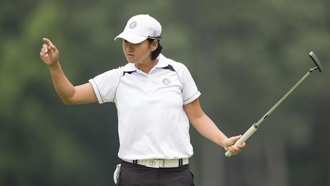 Tseng Yani reacts after a birdie putt during the first round of the LGPA International Crown at Caves Valley Golf Club in Owings Mills, Maryland, July 24, 2014