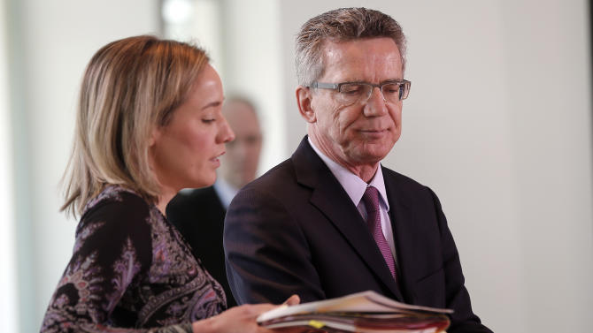 German Defense Minister Thomas de Maiziere, right, and Family Minister Kristina Schröder attend a cabinet meeting in Berlin, Germany, Wednesday, June 5, 2013. De Maiziere presents his report on his ministry's failed drone program to lawmakers in Berlin. He is under pressure for how he handled the drone program which cost the government 600 million euros. (AP Photo/Frank Augstein)