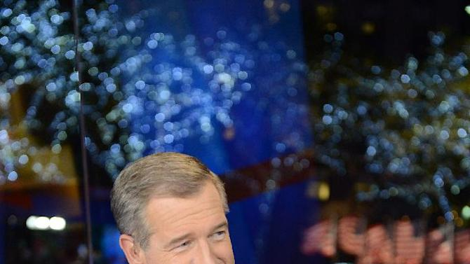 This image released by NBC shows NBC News anchor Brian Williams during election night coverage early Wednesday, Nov. 7, 2012 in New York's Rockefeller Plaza.  (AP Photo/NBC, Jonathan Orenstein)