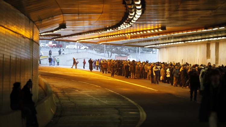 FILE - This Jan. 20, 2009 file photo shows the line of purple ticket holders stretching out the other side of the 3rd Street tunnel in Washington, as they stand in line to watch the inauguration of Barack Obama at the U.S. Capitol, in Washington. While Washington won't likely see the record-setting turnout from the last inauguration, officials are planning for a bigger-than-average crowd making plans for a second chance to see a president's swearing in. District of Columbia officials have pieced together early data projecting 600,000 to 800,000 people will crowd onto the National Mall on Jan. 21. That's based on past attendance and data including hotel and restaurant reservations and chartered buses. The inauguration is the biggest event every four years in the nation's capital, followed by July 4th celebrations. The 2009 inaugural drew 1.8 million.  (AP Photo/Jacquelyn Martin, File)