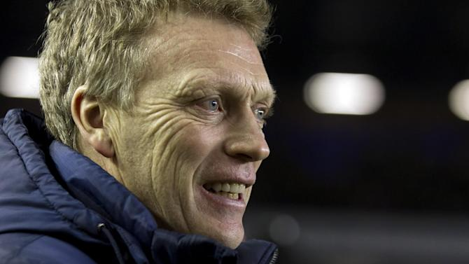 FILE - This is a Tuesday Feb. 26, 2013 file photo of  Everton's manager David Moyes as he takes to the touchline before his team's   English FA Cup fifth round replay soccer match against Oldham at Goodison Park Stadium, Liverpool, England. Everton said Thursday May 9, 2013 that its  manager David Moyes is leaving the club at the end of the season and wants to replace Alex Ferguson at Manchester United. While United has not yet made an announcement on who will succeed Ferguson at Old Trafford, the statement from Everton clears the way for Moyes to be hired. (AP Photo/Jon Super, File)