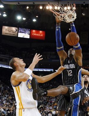 Howard breaks FT attempts mark, Magic top Warriors
