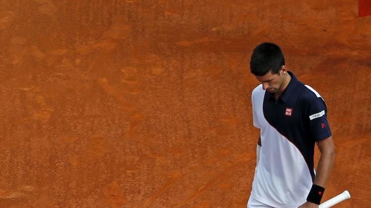 Djokovic walks on the central court during his match against Federer during their semi-final match at the Monte Carlo Masters in Monaco