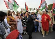 Women activists of the ruling Pakistan People&#39;s Party (PPP) dance as they celebrate the election of Raja Pervez Ashraf as Pakistan&#39;s new prime minister outside the lower house of parliament in Islamabad