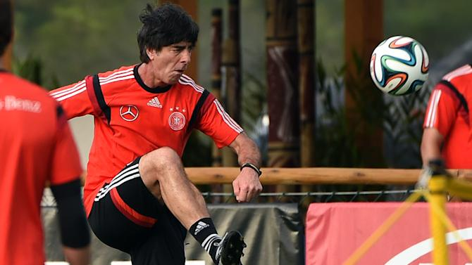 Germany's coach Joachim Loew passes the ball during a training session of Germany's national football team in Santo Andre on July 10, 2014