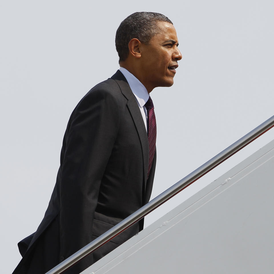 President Barack Obama boards Air Force One, Friday, June 22, 2012, in Andrews Air Force Base, Md., en route to Florida. (AP Photo/Carolyn Kaster)