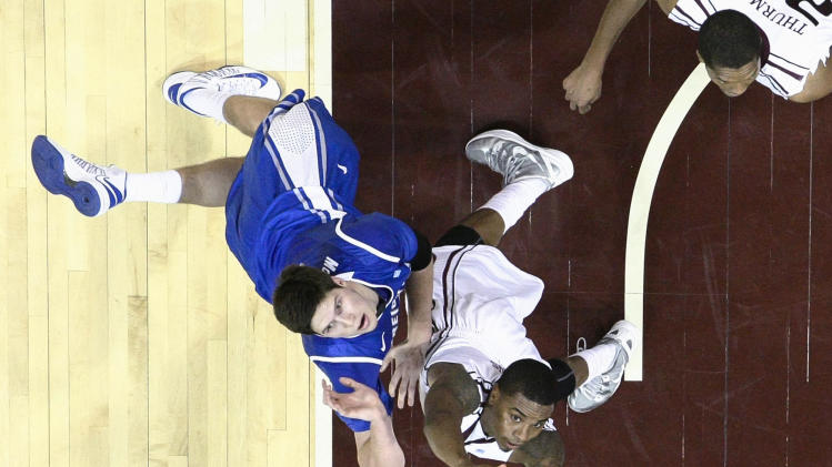 Creighton forward Doug McDermott, left, shoots over Missouri State forward Keith Pickens during the second half of an NCAA college basketball game Friday, Jan. 11, 2013, in Springfield, Mo. Creighton won 74-52. (AP Photo/David Welker)