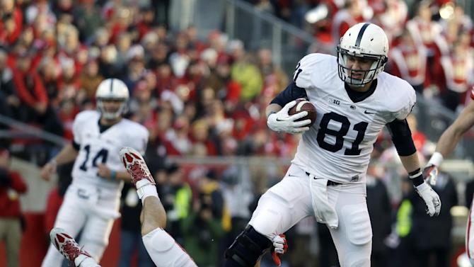 Penn State's Adam Breneman (81) gets past Wisconsin's Nate Hammon for a 68-yard touchdown catch during the first half of an NCAA college football game on Saturday, Nov. 30, 2013, in Madison, Wis