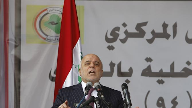 File photo of Iraqi PM Haider al-Abadi speaking during the Iraqi Police Day's at a police academy in Baghdad