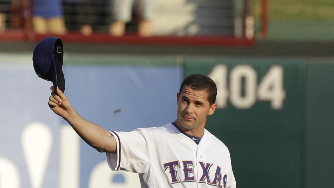 FILE - In this Aug. 11, 2012, file photo, Texas Rangers Michael Young waves to fans before a baseball game in Arlington, Texas. A person familiar with the trade says the Philadelphia Phillies have acquired the seven-time All-Star from the Texas for two relief pitchers. Young agreed to waive his no-trade clause on Saturday, Dec. 8, 2012, the person said, speaking on condition of anonymity because the deal hasn't been announced. (AP Photo/LM Otero, File)