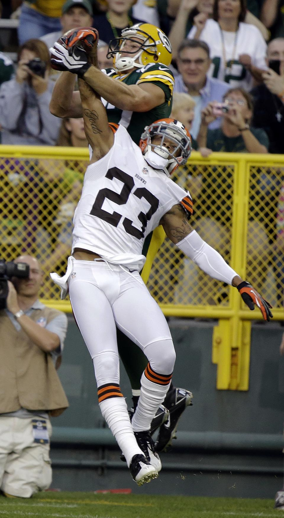 Green Bay Packers wide receiver Jordy Nelson catches a touchdown pass over Cleveland Browns defensive back Joe Haden (23) during the first half of a preseason NFL football game Thursday, Aug. 16, 2012, in Green Bay, Wis. (AP Photo/Morry Gash)