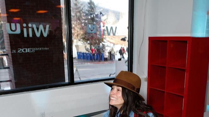 Actress Abigail Spencer warms up and checks out Wii U at the Nintendo Lounge while playing Wii Fit U during a break from the Sundance Film Festival on Monday, Jan. 21, 2013 in Park City, Utah. (Photo by Todd Williamson/Invision for Nintendo/AP Images)