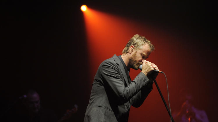 "FILE - This May 21, 2010 file photo shows Matt Berninger, of the band The National, performing during a concert in Los Angeles.  The Tribeca Film Festivall announced Thursday that ""Mistaken for Strangers,"" which documents the National on tour, will premiere April 17. The film is directed by Tom Berninger, a roadie for the band and brother to lead to singer Matt Berninger. The Tribeca Film Festival runs April 17 through April 28. It will next week announce the feature film slate for its 12th annual festival. (AP Photo/Chris Pizzello, file)"