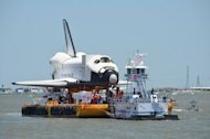 "The space shuttle replica formerly known as ""Explorer"" approaches a dock in Clear Lake, Houston after arriving in Houston on June 1, 2012. The shuttle will be delivered to Space Center Houston for public display."