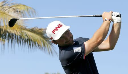 Andy Sullivan of England tees off on the 13th hole during the final round of the Dubai Desert Classic