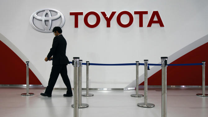 An employee of Toyota Motor Corp. prepares for an event at Mega Web, a renewed Toyota gallery in Tokyo Wednesday, Nov. 6, 2013. Toyota Motor Corp. said a weaker yen and cost cuts pushed up quarterly profit by 70 percent. The automaker said Wednesday its July-September net profit rose to 438.4 billion yen ($4.4 billion) from 257.9 billion yen a year earlier. (AP Photo/Junji Kurokawa)