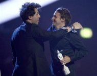 Singer Ben Howard (R) is presented with the British Breakthrough Act award by television presenter Nick Grimshaw at the BRIT Awards, celebrating British pop music, at the O2 Arena in London February 20, 2013. REUTERS/Dylan Martinez