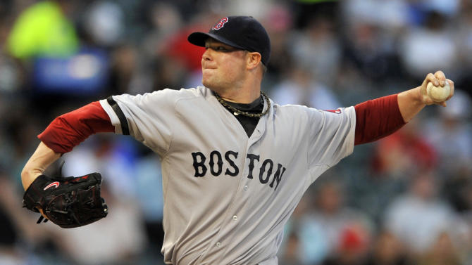 Boston Red Sox starter Jon Lester delivers a pitch during the first inning of a baseball against the Chicago White Sox in Chicago, Monday, May 20, 2013.(AP Photo/Paul Beaty)