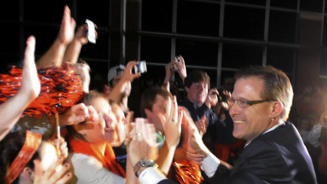 Newly hired Auburn football coach Gus Malzahn arrives at Auburn University Regional Airport and greets fans Tuesday, Dec. 4, 2012, in Auburn, Ala. (AP Photo/AL.com, Julie Bennett) MAGS OUT