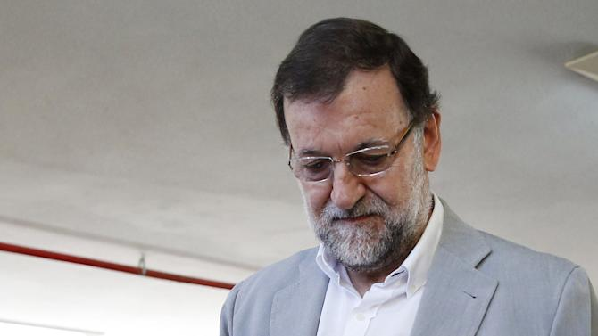 Spain's Prime Minister Rajoy votes at a polling station during regional and municipal elections in Madrid