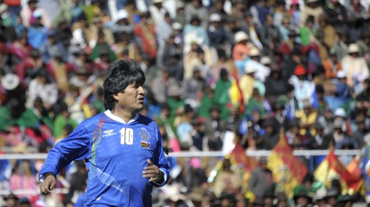Handout photo shows Bolivia's President Evo Morales, seen during a friendly soccer match held at the inauguration of a sport field at Lake Titicaca in Copacabana