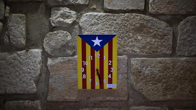 "In this photo taken on Tuesday, Nov. 19, 2012, a clock bearing the ""estelada"" flag that symbolizes Catalonia's independence is displayed for sale in a book shop in Girona, Spain. Catalonia holds elections on Sunday that will be seen as a test of the regional government's plans to hold a referendum on independence, and one of the key issues emerging is the theoretical place of a free Catalonia in Europe. (AP Photo/Emilio Morenatti)"
