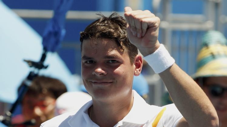 Milos Raonic of Canada acknowledges the crowd after defeating Daniel Gimeno-Traver of Spain in their men's singles match at the Australian Open 2014 tennis tournament in Melbourne