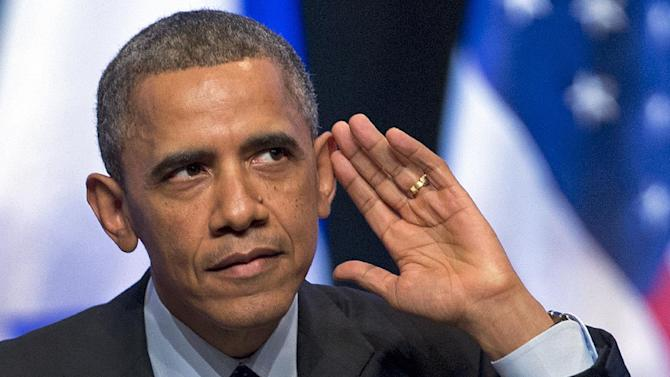 President Barack Obama looks into the crowd and tries to hear a person yelling at him during his speech at the International Convention Center in Jerusalem, Thursday, March 21, 2013. (AP Photo/Carolyn Kaster)