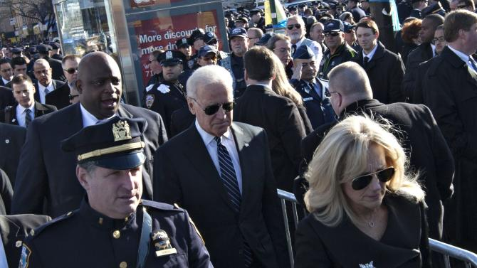 U.S. Vice President Biden and his wife Jill arrive for the funeral service for slain NYPD officer Ramos at the Christ Tabernacle Church in the Queens borough of New York