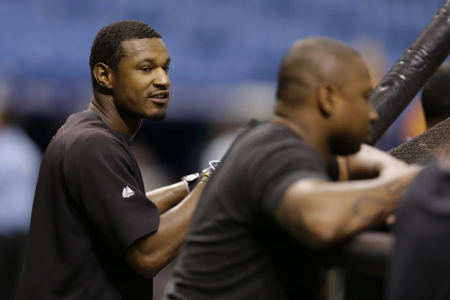 Adam Jones (left) and Delmon Young. (AP)