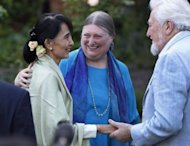 "Myanmar democracy icon Aung San Suu Kyi (L) meets with old friends at a reception at St Hugh's College in Oxford. Suu Kyi made an emotional return to Britain on her 67th birthday Tuesday, visiting her former home of Oxford and speaking of the ""sacrifice"" her family were forced to make"