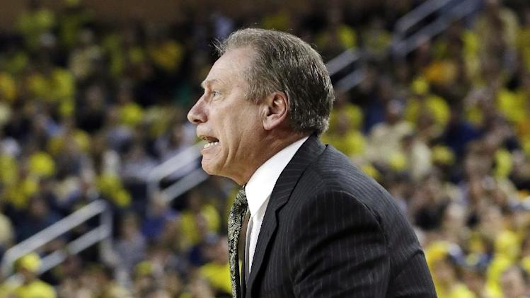Michigan State head coach Tom Izzo reacts during the first half of an NCAA college basketball game against Michigan in Ann Arbor, Mich., Sunday, March 3, 2013. (AP Photo/Carlos Osorio)