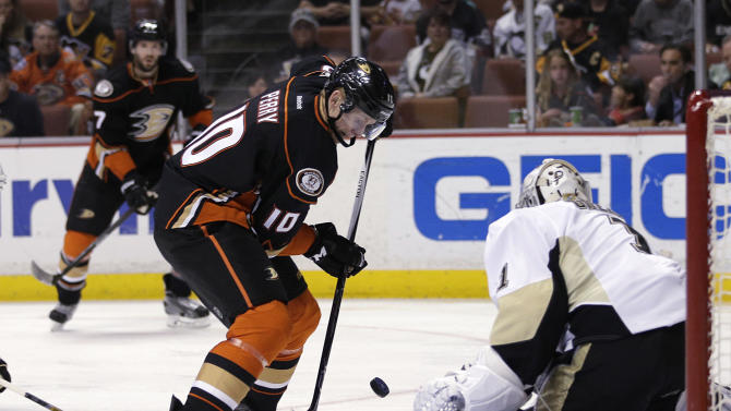 Anaheim Ducks' Corey Perry, left, tries to score against Pittsburgh Penguins goalie Thomas Greiss, of Germany, during the second period of an NHL hockey game, Friday, March 6, 2015, in Anaheim, Calif. (AP Photo/Jae C. Hong)