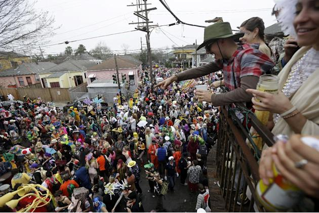 Revelers gather for the start of the Society of Saint Anne walking parade in the Bywater section of New Orleans during Mardi Gras day, Tuesday, Feb. 12, 2013.  Overcast skies and the threat of rain co