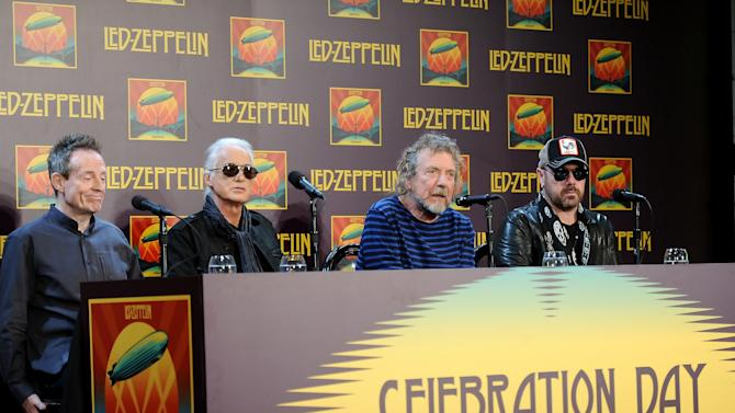 "Led Zeppelin, from left, bassist/keyboardist John Paul Jones, guitarist Jimmy Page, singer Robert Plant, and drummer Jason Bonham participate in a press conference ahead of the worldwide theatrical release of ""Celebration Day"", a concert film of their 2007 London O2 arena reunion show, at the Museum of Modern Art on Tuesday, Oct. 9, 2012 in New York. (Photo by Evan Agostini/Invision/AP)"
