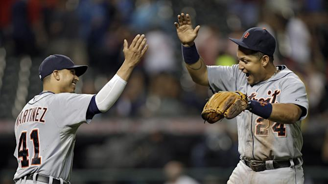 Detroit Tigers' Miguel Cabrera (24) celebrates with Victor Martinez (41) after a 4-2 win in 10 innings over the Cleveland Indians in a baseball game Monday, July 8, 2013, in Cleveland. Martinez drove in Cabrera and Prince Fielder with a double in the 10th for the win. (AP Photo/Mark Duncan)