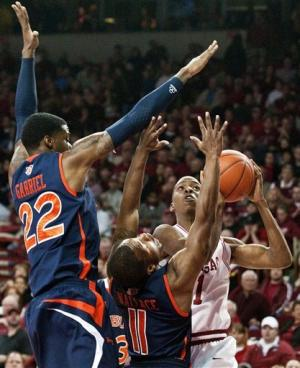 Arkansas holds off Auburn 56-53 behind Young's 11